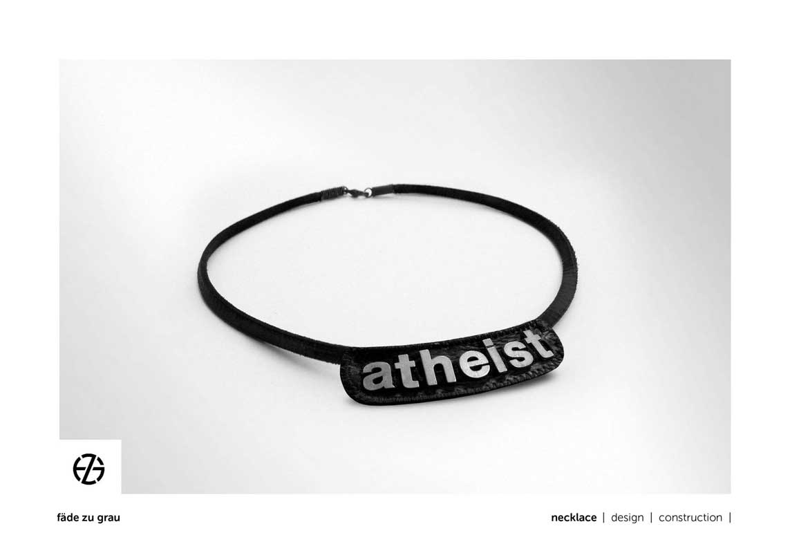 "black leather band necklace with metal letters spelling ""atheist"""