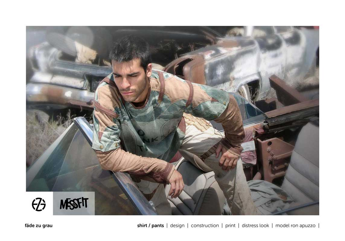 male fashion model in a junk yard presents brown and green shirt