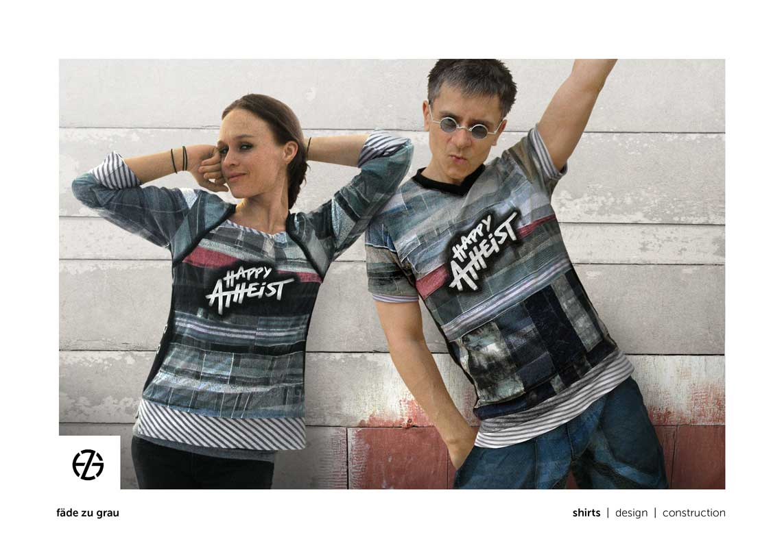 "female model and artist fade zu grau presenting t-shirt with the saying ""happy atheist"""