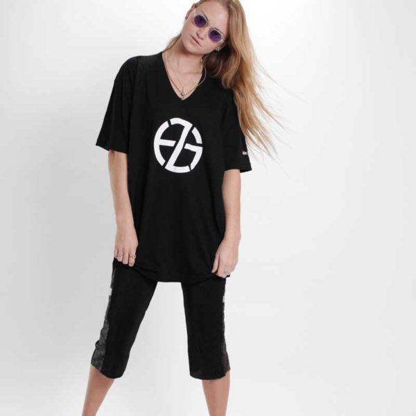 female model presents black t-shirt with white logo symbol print, front view