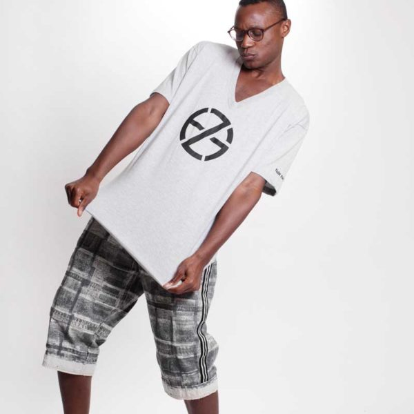 male model presents gray t-shirt with black logo print, front view